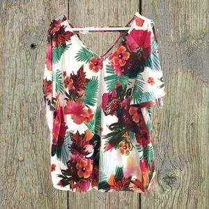 Tropical print, cold shoulder top.